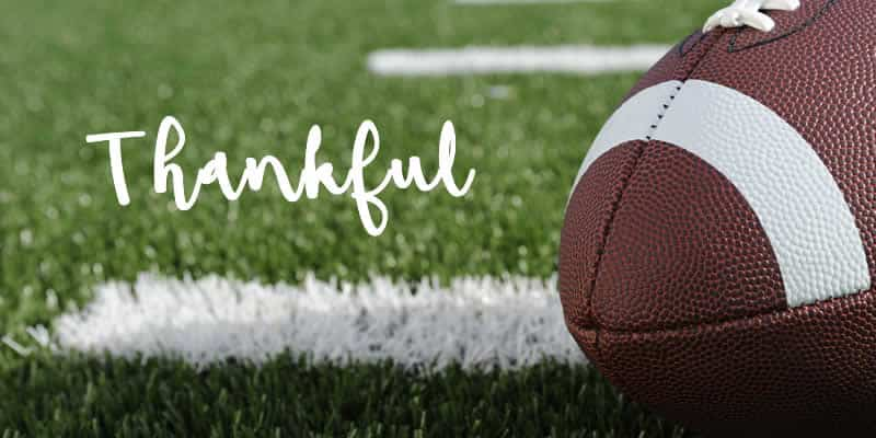 the word thankful on football field