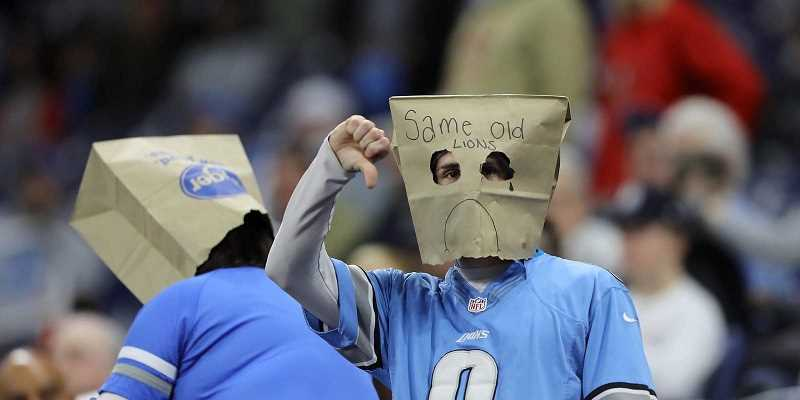 Detroit Lions fan with bag on head and thumbs down